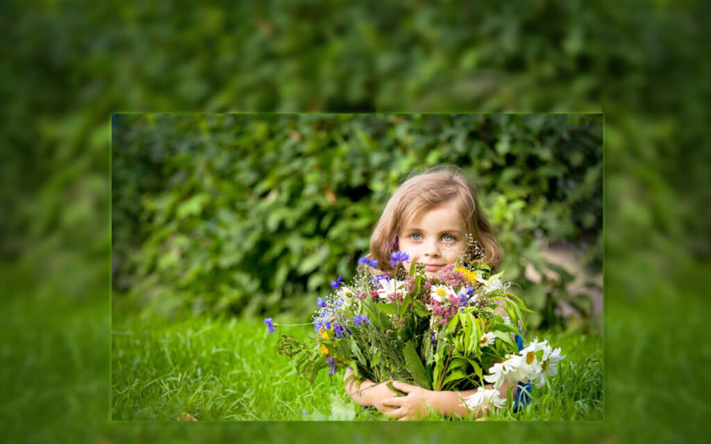 girl-holding-flowers-in-garden